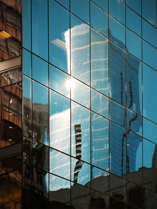 Buildings south of Washington Street in Chicago's Loop, reflected in the south windows of the CBS building